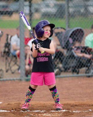 Girl Batting in softball game