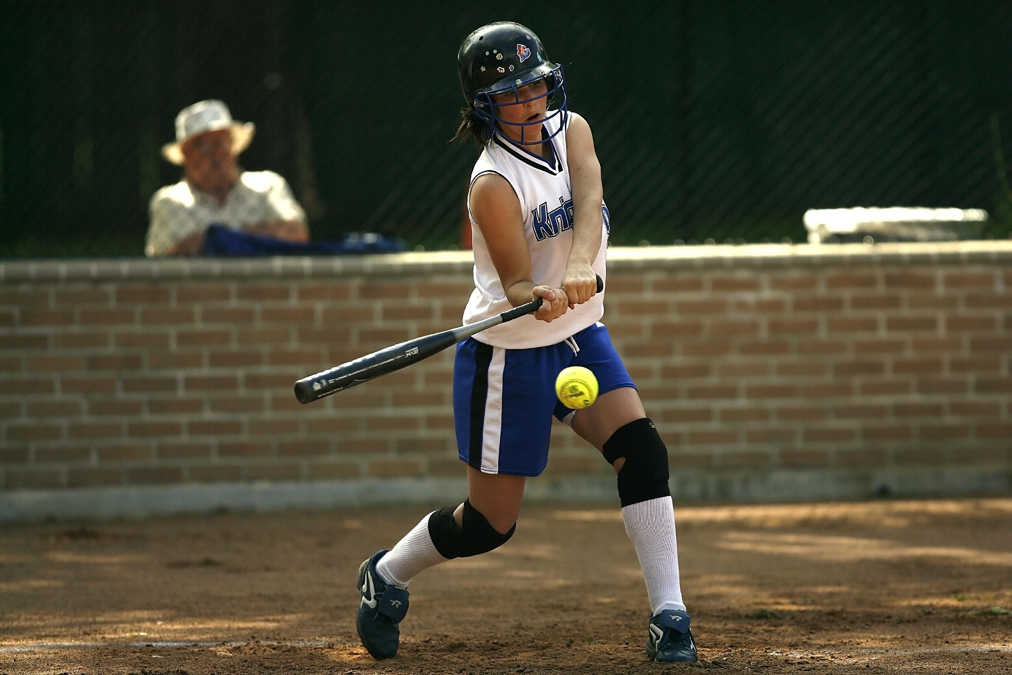 Girl Swinging Fastpitch Softball Bat